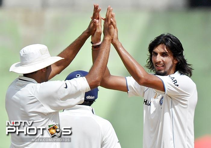 Ishant Sharma celebrates with teammates after completing his five-wicket haul during the second day of third and final Test match between India and the West Indies at the Windsor Park Stadium in Roseau, Dominica. (AFP Photo)