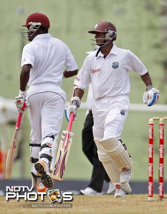 Darren Bravo and Shivnarine Chanderpaul run between the wickets on the second day of the third Test match against India in Roseau, Dominica. (AP Photo)