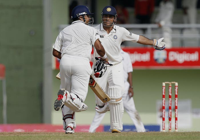Suresh Raina and Mahendra Singh Dhoni run between the wickets during the third day of the third Test match against the West Indies in Roseau, Dominica. (AP Photo)