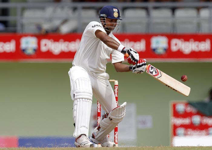 Suresh Raina plays a shot during the third day of the third Test match against the West Indies in Roseau, Dominica. (AP Photo)
