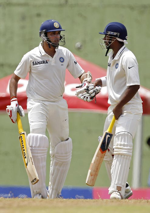 VVS Laxman and teammate Abhinav Mukund bump fists on the third day of the third Test match against the West Indies in Roseau, Dominica. (AP Photo)