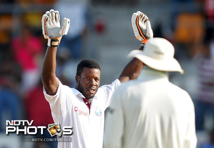 Kirk Edwards celebrates after scoring his century during the fourth day of third and final Test match between India and West Indies at the Windsor Park Stadium in Roseau, Dominica. (AFP Photo)