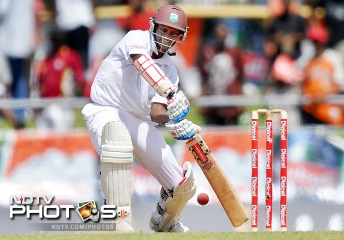Shivnarine Chanderpaul plays a shot off Ishant Sharma during the fourth day of third and final Test match between India and West Indies at the Windsor Park Stadium in Roseau, Dominica. (AFP Photo)