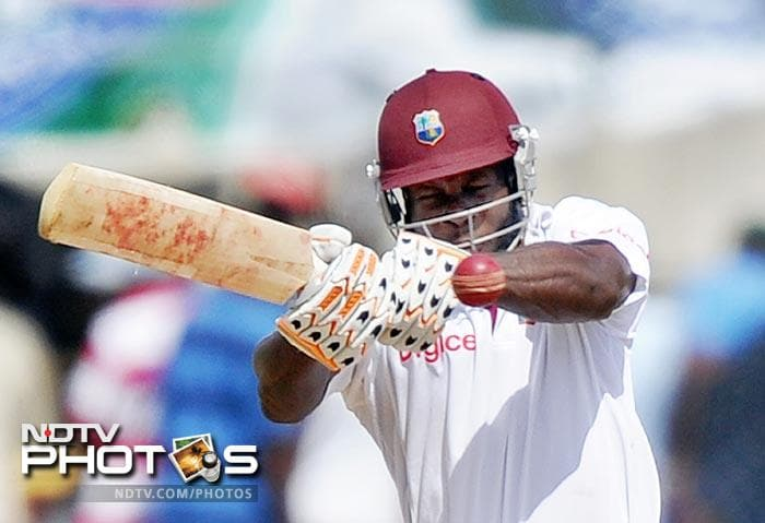 Kirk Edwards hits a boundary off Ishant Sharma to score his half-century during the fourth day of third and final Test match between India and West Indies at the Windsor Park Stadium in Roseau, Dominica. (AFP Photo)