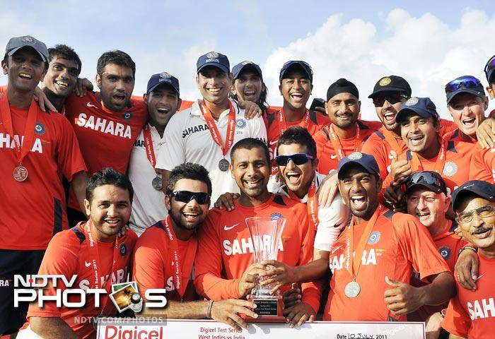 Indian team pose with their series winning trophy at the end of the third and final Test match between India and West Indies at the Windsor Park Stadium in Roseau, Dominica. (AFP Photo)