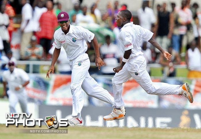 Fidel Edwards celebrates dismissing Abhinav Mukund with his very first ball during the fifth day of the third and final Test match between India and West Indies at the Windsor Park Stadium in Roseau, Dominica. (AFP Photo)