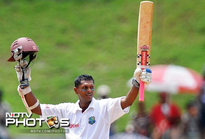 Shivnarine Chanderpaul celebrates scoring his century during the fifth day of third and final Test match between India and West Indies at the Windsor Park Stadium in Roseau, Dominica. (AFP Photo)