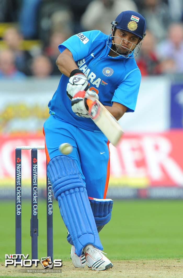 Suresh Raina once again proved he's a different player when playing ODIs as he smashed 2 sixes and 2 fours in his 29-ball 38. (AFP Photo)