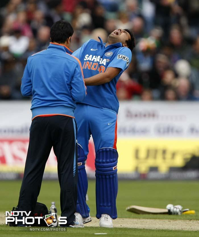 Rohit Sharma had a very short stay at the crease as he retired hurt after just one ball after being hit on his hand off a Stuart Broad delivery. His departure brought Raina to the crease.(AP Photo)