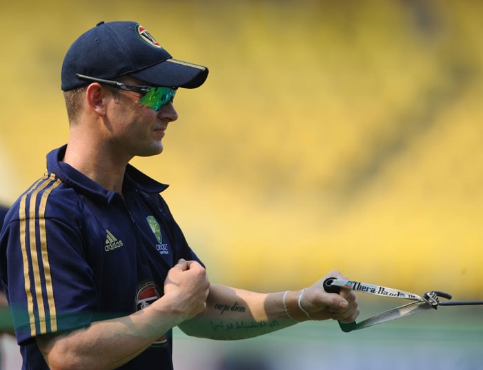 Australian captain Michael Clarke stretches during a practice session ahead of the second One Day International (ODI) cricket match between India and Australia at the practice ground of the Dr. Y.S. Rajasekhara Reddy ACA-VDCA Cricket Stadium in Visakhapatnam on October 19, 2010. Australia is scheduled to play two more match ODI series against host India, after the first one was abandoned due to bad weather. (AFP Photo)