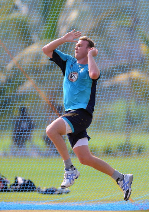 Australian cricketer Doug Bollinger prepares to deliver a ball during a practice session. (AFP Photo)