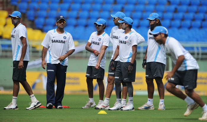 India's captain MS Dhoni (2L) gestures as he take part in a net practice session along with team mates ahead of the second One Day International (ODI) cricket match between India and Australia at the practice ground of the Dr. Y.S. Rajasekhara Reddy ACA-VDCA Cricket Stadium in Visakhapatnam on October 19, 2010. (AFP Photo)