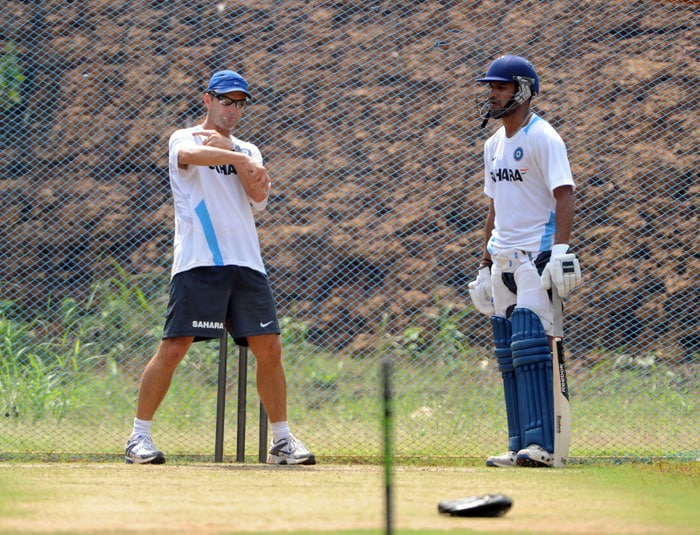 India's coach Gary Kirsten (L) coaches cricketer Shikhar Dhawan during a net practice session. (AFP Photo)