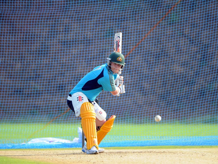 Australian cricketer David Warner plays a shot during a net practice session ahead of the second One Day International (ODI) cricket match between India and Australia. (AFP Photo)