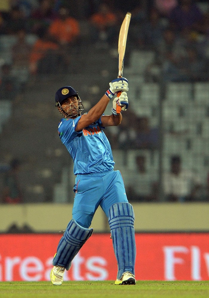 Rohit fell but MS Dhoni walked out at No.4 and finished the game in trademark style with a big six to guide India to the semis of the tournament for the first time since 2007.