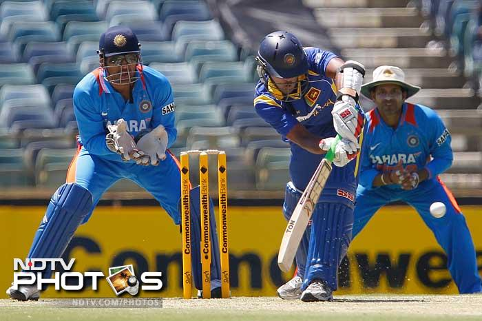 Dinesh Chandimald plays a shot as he went onto top-score for his side with 64 runs. Sri Lanka managed to set India a target of 234.