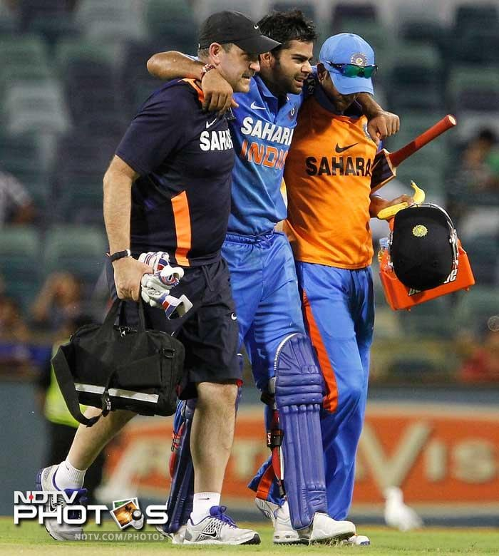 Kohli was eventually run-out and had to be carried off the field as he had developed cramps.