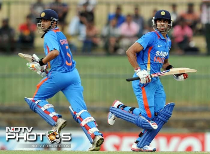 India had won the toss and opted to bat. Ajinkya Rahane got to play but took 9 from his innings. In the image, Gambhir and Manoj Tiwary (65) are seen taking a run.
