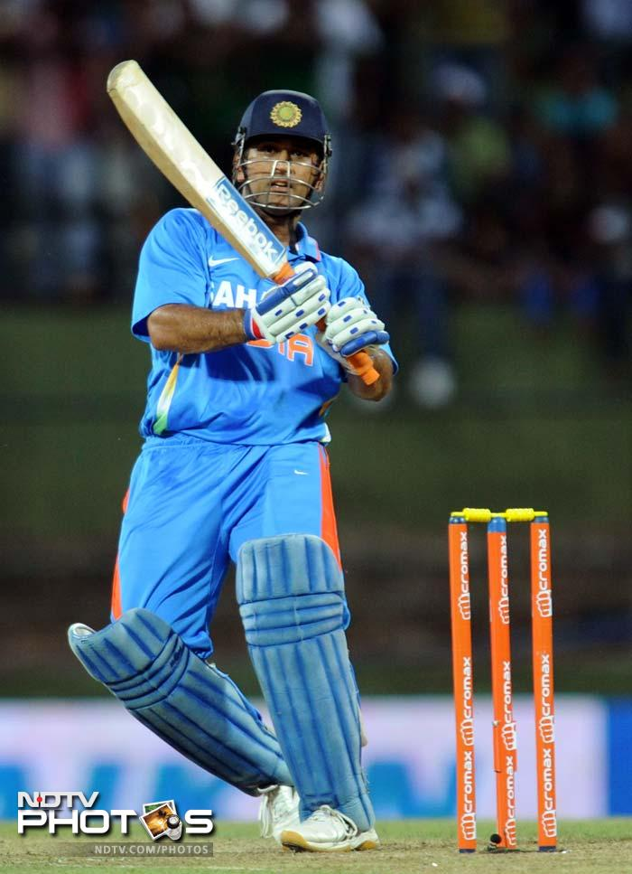 MS Dhoni in action en route to his half-century. He scored 58 to help India post 294.