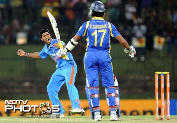Ashok Dinda celebrates the wicket of Dinesh Chandimal (8). The bowler took two wickets from the match.
