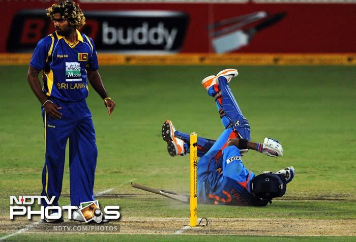 Vinay Kumar (seen here diving) joined ranks with Irfan Pathan and Gambhir as the players who fell to Sri Lankan fielding.