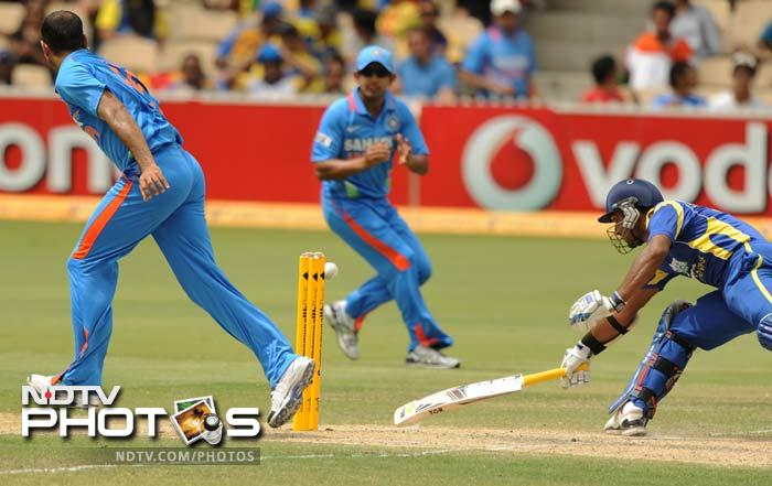 Kumar Sangakkara is seen here making his ground as Indian fielders attempt to run him out. Sri Lanka had won the toss and had opted to set a target.