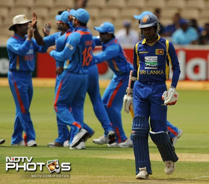 India celebrates the dismissal of Sri Lanka's Upul Tharanga (R) who was the first batsman to be dismissed. He failed to open his account.
