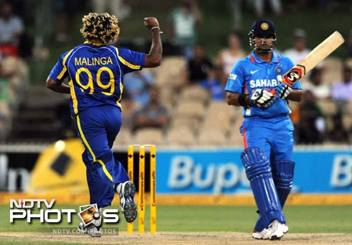Suresh Raina (R) is seen here after he was dismissed by Lasith Malinga on 8. Raina edge a ball for Sangakkara to complete a regulation wicket-keeping catch.
