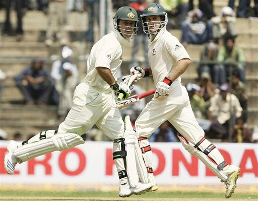 Ricky Ponting and Simon Katch score a run on the first day of the first Test between India and Australia in Bangalore.