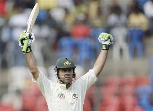 Ricky Ponting reacts after scoring a century on the first day of the first Test between India and Australia in Bangalore.