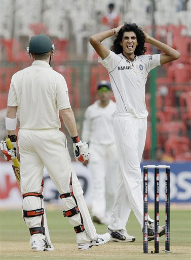 Ishant Sharma reacts after bowling a delivery to Brad Haddin on the second day of the first Test match between India and Australia in Bangalore.