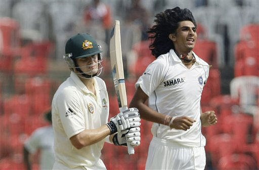 Ishant Sharma reacts after taking the wicket of Shane Watson on the second day of the first Test match between India and Australia in Bangalore.