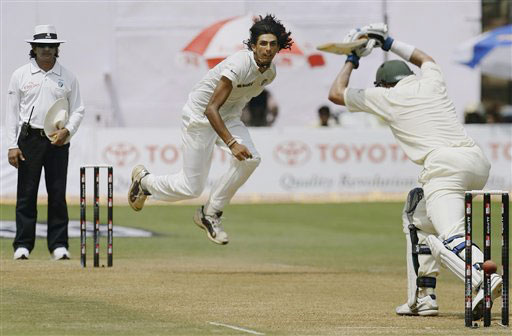 Ishant Sharma bowls to Mike Hussey on the second day of the first Test match between India and Australia in Bangalore.