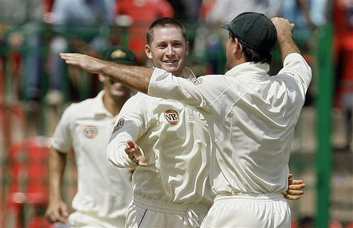 Ricky Ponting congratulates Michael Clarke for dismissing Mahendra Singh Dhoni on the third day of the first Test in Bangalore.