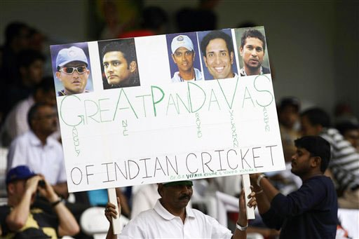 A cricket fan holds a placard bearing the photographs of Indian cricketers Sourav Ganguly, Anil Kumble, Rahul Dravid, V.V.S. Laxman and Sachin Tendulkar on the fourth day of the first Test between India and Australia in Bangalore.
