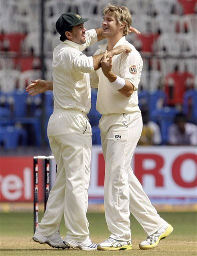Ricky Ponting congratulates Shane Watson after he took the wicket of Anil Kumble on the fourth day of the first Test between India and Australia in Bangalore.