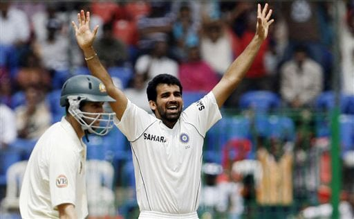 Zaheer Khan reacts after taking the wicket of Matthew Hayden as Simon Katich looks on during the fourth day of the first Test between India and Australia in Bangalore.