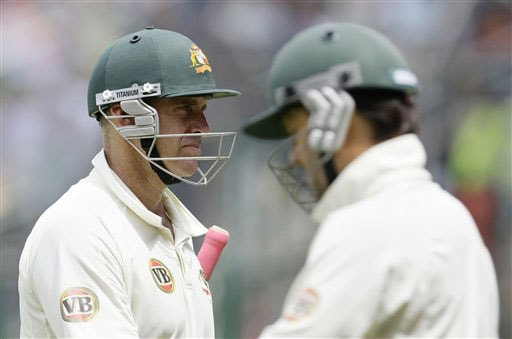 Matthew Hayden returns to the pavillion after losing his wicket as Ricky Ponting enters on the fourth day of the first Test between India and Australia in Bangalore.
