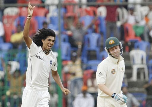 Ishant Sharma reacts after dismissing Michael Clarke on the fourth day of the first Test between India and Australia in Bangalore.