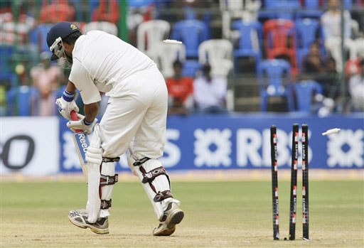 Gautam Gambhir is clean bowled by Mitchell Johnson on the final day of the first Test match between India and Australia in Bangalore.