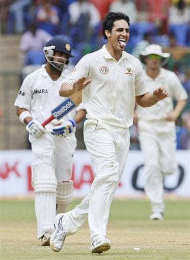 Mitchell Johnson celebrates after dismissing Gautam Gambhir on the final day of the first Test match between India and Australia in Bangalore.