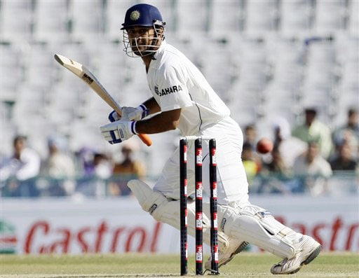 Mahendra Singh Dhoni plays a shot on the second day of the Mohali Test between India and Australia.