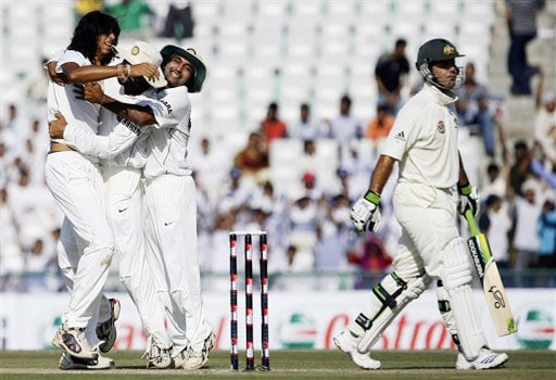 Ishant Sharma is congratulated by Harbhajan Singh and Amit Mishra after taking the wicket of Ricky Ponting on the second day of the Mohali Test between India and Australia.