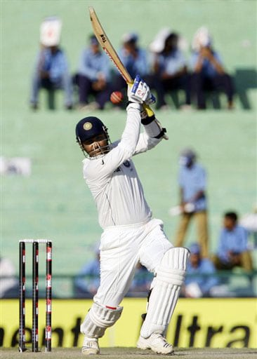 Virender Sehwag plays a shot on the third day of the second Test between India and Australia in Mohali.