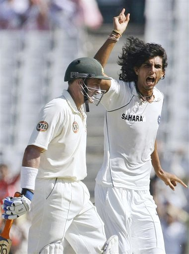Ishant Sharma reacts after taking the wicket of Mike Hussey on the third day of the second Test between India and Australia in Mohali.