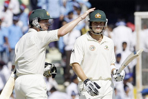 Brett Lee congratulates Shane Watson after he scored fifty runs on the third day of the second Test between India and Australia in Mohali.