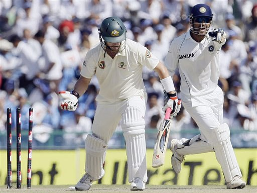 Mahendra Singh Dhoni reacts after Cameron White is clean-bowled by Amit Mishra on the third day of the second Test between India and Australia in Mohali.