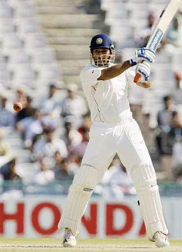 Mahendra Singh Dhoni plays a shot on the fourth day of the second Test between India and Australia in Mohali.