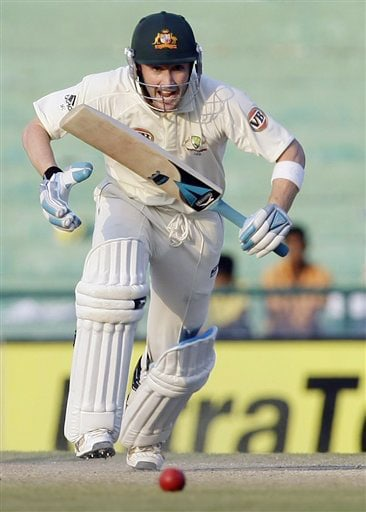 Michael Clarke scores a run during the fourth day's play of the second Test between India and Australia in Mohali.