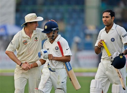 Gautam Gambhir is congratulated by Brett Lee as Indian VVS Laxman, right, looks on as they return after end of play on the first day of their third cricket Test match in New Delhi on Wednesday, October 29, 2008. Gambhir scored his second hundred in consecutive matches with an unbeaten 149.